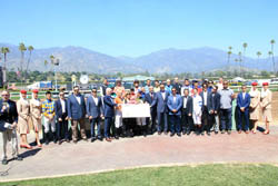 Hall of Fame jockeys Mike Smith, Gary Stevens and Laffit Pincay Jr. accept donation